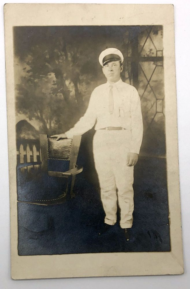Real photo postcard / RPPC ca. 1910 showing portrait of a man (note on rear indicates that he is a baker)