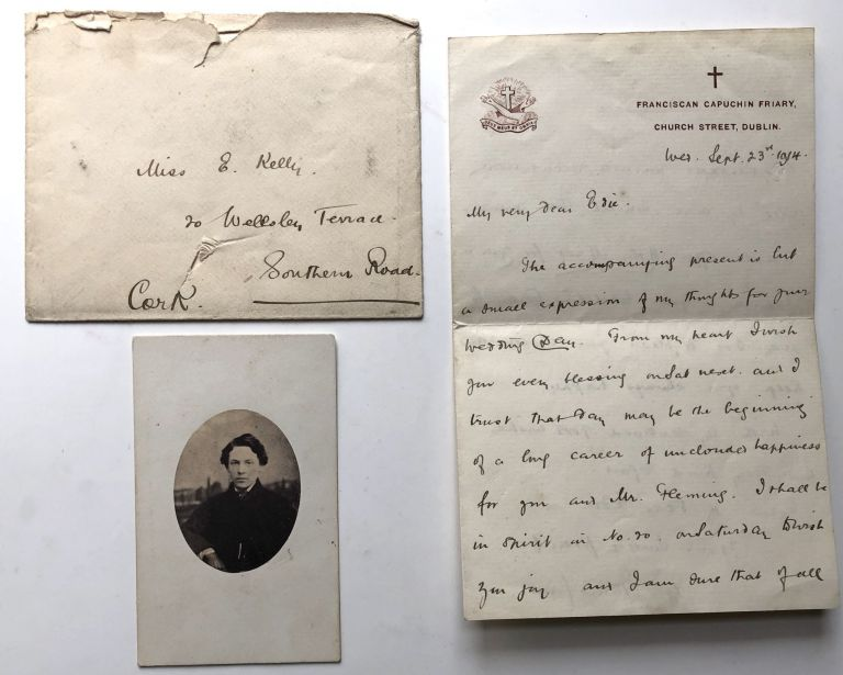 "1914 Letter from Father Stanislaus, Capuchin Friary, Dublin, enclosing small photograph signed on the back, ""May 1899, James Joyce, Dublin"" James Joyce."