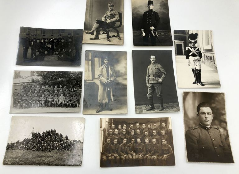 10 military postcards, mainly Real Photo, WWI & before, European & American, battalions, officers: R. A. M. C. (New Army) Record Office Staff; Polish officer; Sitting young officer, note in Slavic (we think), RPPC of an officer, Sarajevo; Officer in full military regalia, Rome; Portrait of an Italian officer, signed on the back Frederici Defrancesco; Battalion outside on a hill (Czech), 1913 RPPC of a German gunnery battalion