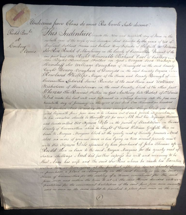 """18th century copy of a large legal document from 1641 providing """"four poor men"""" with money and lodging in Carmarthen, Wales. Wales."""