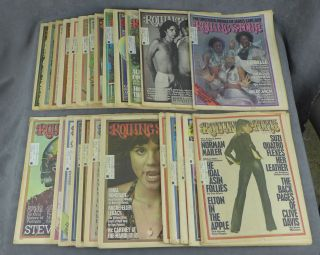 Near complete run of Rolling Stone magazine from 1975--25 issues total (missing no. 182). Jann...