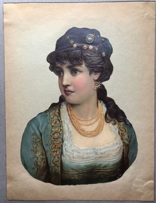 1890s die-cut of woman in fetching hat and lots of bling, 9.5 x 7 inches
