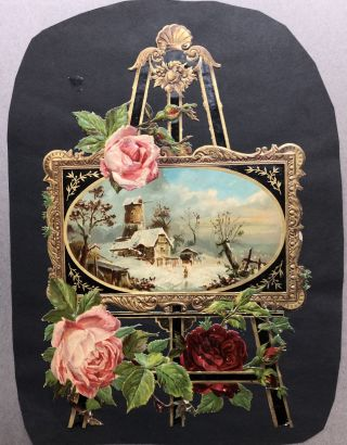 1890s large die-cut of an easel holding a painting of a winter scene