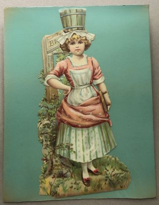 1890s large die-cut of girl holding scrub-brush and balancing bucket on her head
