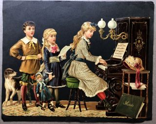 1890s large die-cut of kids gathering around a piano and singing