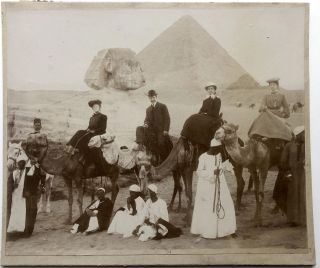 1890s photo of tourists in Egypt in front of the Sphinx, pyramid in distance