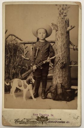 Cabinet Photo of a boy named Herbert Schneider with gun & dog (or statue of dog) taken in Sao...
