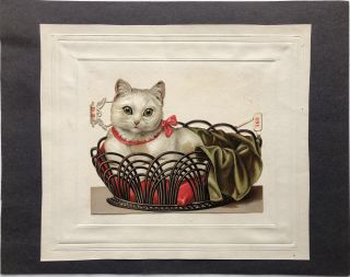 1890s die-cut of a kitten in a basket