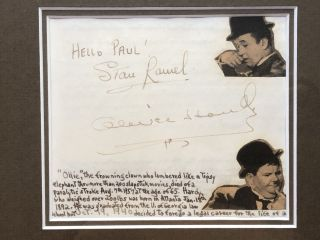 Autographs of Laurel and Hardy in 1940, matted and framed with photo